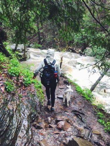 Husky and girl hiking together