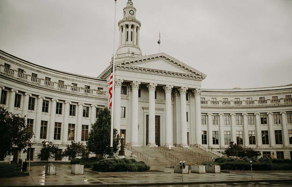 White building with tall pillars