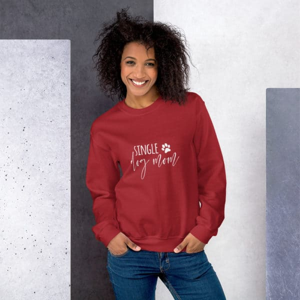 "girl wearing red ""single dog mom"" sweater"
