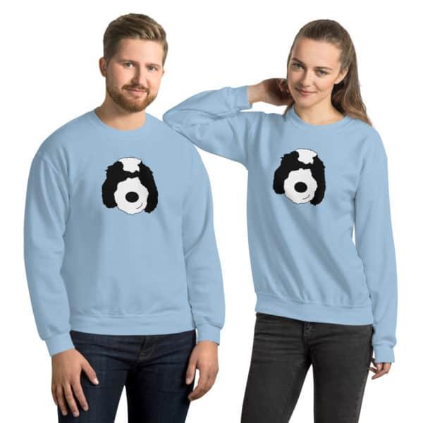 man and woman wearing matching blue sweaters