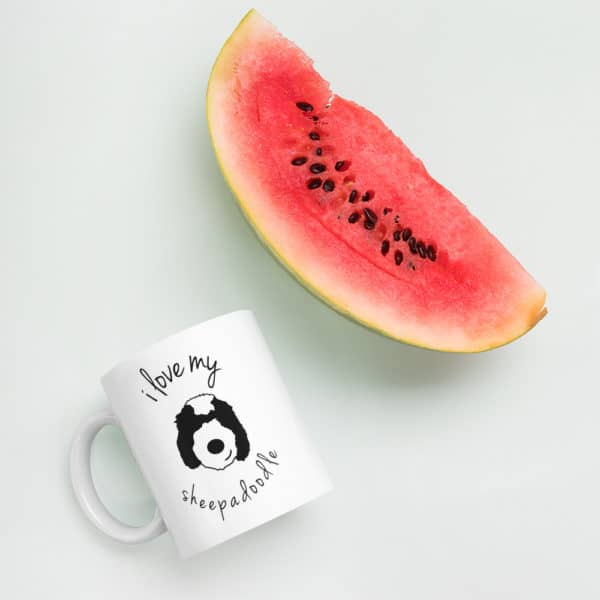 Coffee mug beside a slice of watermelon