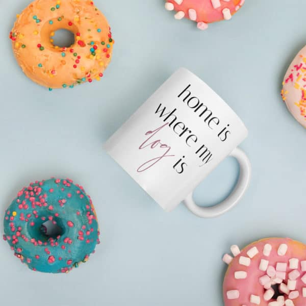 coffee mug and colorful donuts
