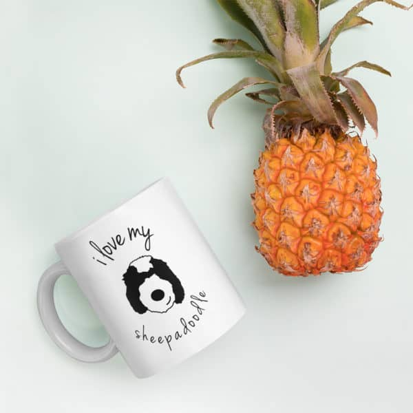 coffee mug beside a pineapple