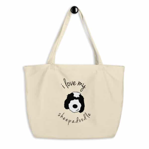 A tote with a cartoon dog face on it