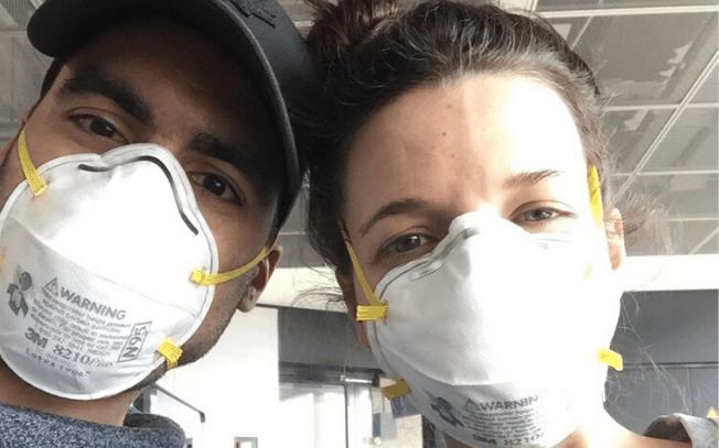 Man and woman wearing N95 masks