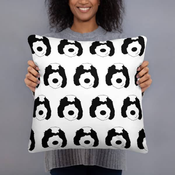 Pillow with cartoon dog faces all over
