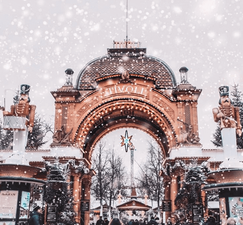 Snow falling at a theme park entrance
